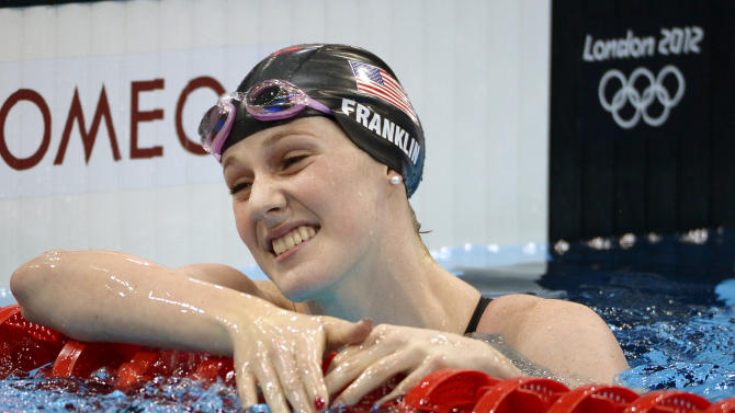 FILE - This Aug. 1, 2012 file photo shows Missy Franklin, of the United States,  reacting after a women's 100-meter freestyle swimming semifinal at the Aquatics Centre in the Olympic Park during the 2012 Summer Olympics in London. Franklin already has five Olympic medals, and she hasn't finished her senior year in high school yet. (AP Photo/Mark J. Terrill, File)