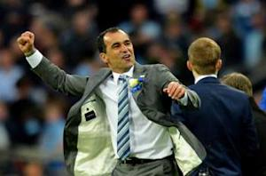 Manchester City 0-1 Wigan Athletic: Late Watson winner stuns Mancini's men in cup final