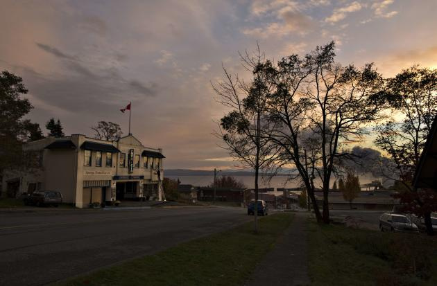 The Patricia Theatre is seen at dusk by the Powell River. (Reuters)