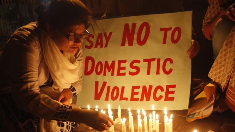 Women light candles while they take part in a rally to commemorate International Women's Day ahead a day in Karachi