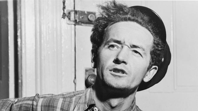 This circa 1943 photo courtesy of the Woody Guthrie Archives shows Oklahoma-born folk singer Woody Guthrie. The Woody Guthrie Center opens to the public on Saturday, April 27, 2013, with many interactive exhibits chronicling the life and work of Guthrie and is home to the folk singer's archives. (AP Photo/Al Aumuller, Courtesy Woody Guthrie Archives)