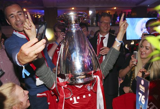 Ski racer Felix Neureuther of Germany celebrates with the trophy over his head during the Bayern Munich Champions League Finale banquet at Grosvenor House on Saturday, May 25, 2013 after winning the s