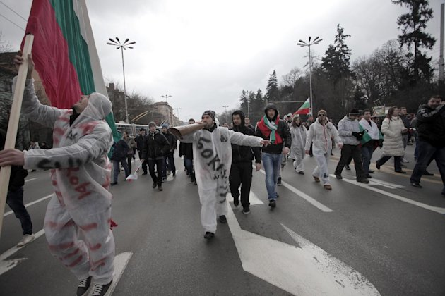 Bulgarians shout slogans as they block the traffic at main road juncture during a protest against higher electricity and heating bills, in Sofia, Sunday, Feb. 17, 2013. Thousands of angry Bulgarians chanted &quot;mafia&quot; and &quot;resignation&quot; demanded the expulsion of the three foreign-controlled power distributors that control the local market: Czech Republic&#39;s CEZ and Energo-Pro, and Austria&#39;s EVN (AP Photo/Valentina Petrova)