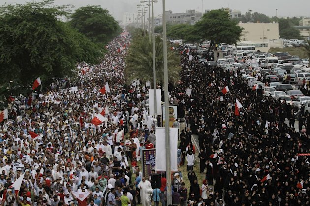 Bahraini anti-government protesters stretch for more than 5 kilometers (3 miles) along a main four-lane divided highway Friday, May 18, 2012, west of the capital of Manama, Bahrain. Tens of thousands 