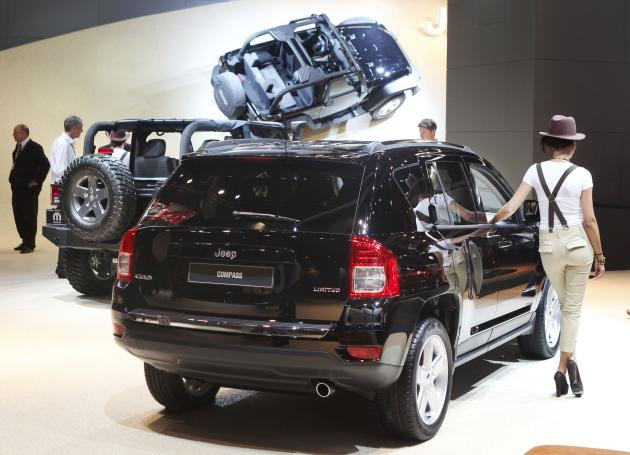Jeeps are presented at the 64th Frankfurt Auto Show in Frankfurt, Germany, Wednesday, Sept.14, 2011. (AP Photo/Michael Probst)
