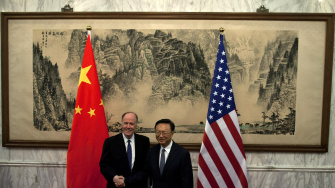 U.S. National Security Adviser Tom Donilon, left, and Chinese State Councilor Yang Jiechi, right, shake hands before their meeting at Diaoyutai State Guesthouse in Beijing, China, Monday, May 27, 2013. (AP Photo/Alexander F. Yuan, Pool)