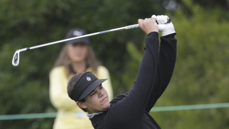 Amateur Beau Hossler hits a shot on the first hole during the first round of the U.S. Open Championship golf tournament Thursday, June 14, 2012, at The Olympic Club in San Francisco. (AP Photo/Eric Gay)