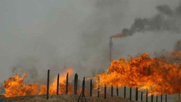 Flared gas burns at the Kirkuk oil field on June 29, 2009