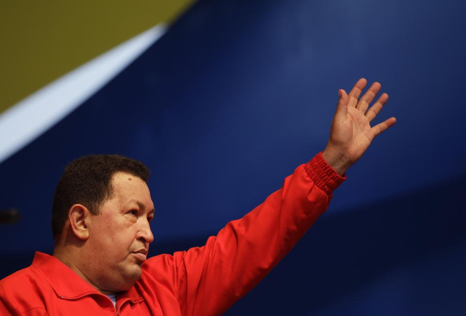Venezuela's President Hugo Chavez waves to supporters during a campaign rally in the Antimano neighborhood of Caracas, Venezuela, Friday, Aug. 3, 2012. Venezuela's presidential election is scheduled for Oct. 7. (AP Photo/Ariana Cubillos)
