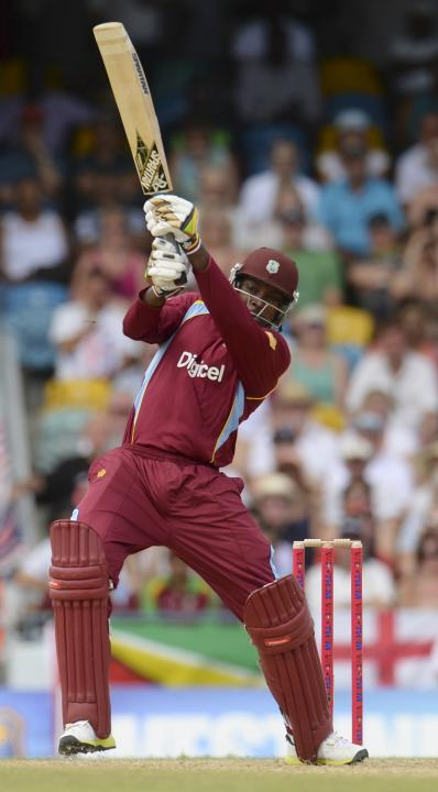 West Indies' Gayle hits out during the first T20 international against England at Kensington Oval in Bridgetown