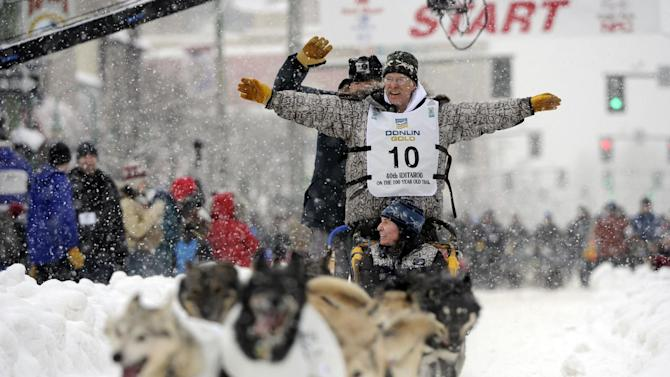 Jeff King waves at race fans on 4th Avenue during the ceremonial start of the Iditarod trail sled dog race, Saturday, March 3, 2012, in Anchorage, Alaska. (AP Photo/The Anchorage Daily News, Marc Lester)