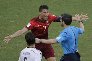Portugal's Cristiano Ronaldo protests to referee Milorad Mazic during his team's loss to Germany. (AP)
