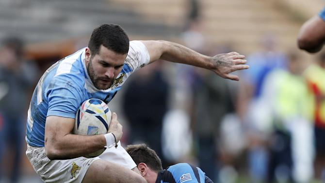 Argentine National rugby team player Paz is tackled by Berchesi of Uruguay's National rugby team during a friendly match in Montevideo