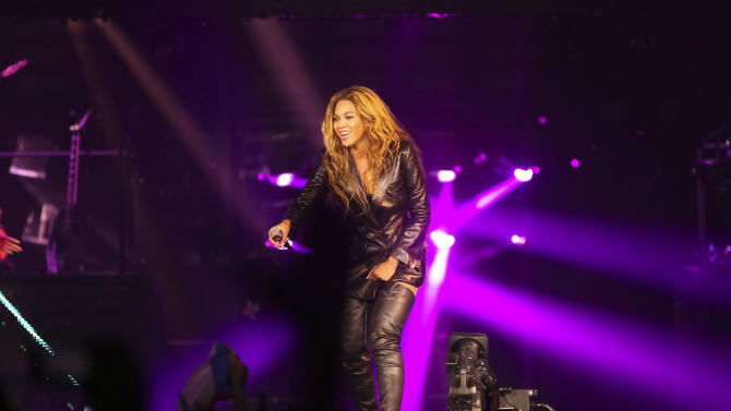 """Singer Beyonce performs on her """"Mrs. Carter Show World Tour 2013"""", on Friday, April 19, 2013 at the Slovnaft Arena in Bratislava, Slovakia. Beyonce is wearing a leather jacket and boots by Pucci. (Photo by Yosra El-Essawy/Invision for Parkwood Entertainment/AP Images."""