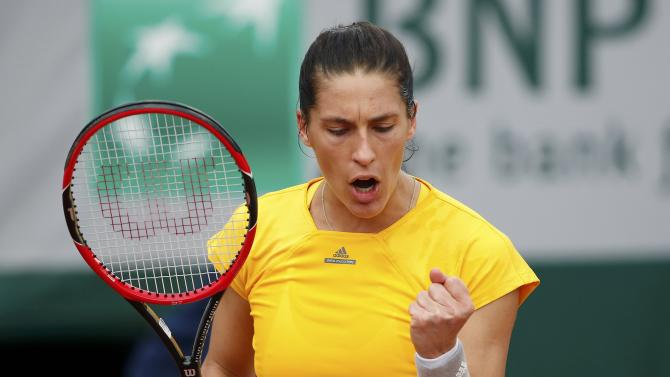 Andrea Petkovic of Germany reacts during the women's singles match against Shelby Rogers of the U.S. at the French Open tennis tournament at the Roland Garros stadium in Paris