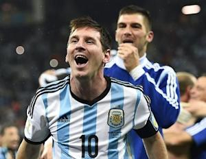 Argentina's Messi celebrates with teammate Andujar their win over the Netherlands at the end of their 2014 World Cup semi-finals at the Corinthians arena in Sao Paulo