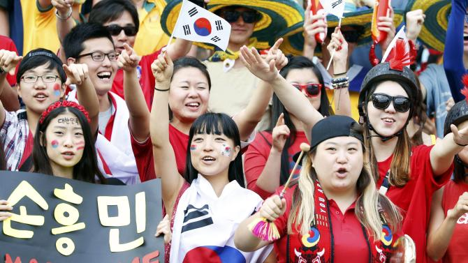 South Korea fans cheer before the start of their Asian Cup final soccer match against Australia at the Stadium Australia in Sydney