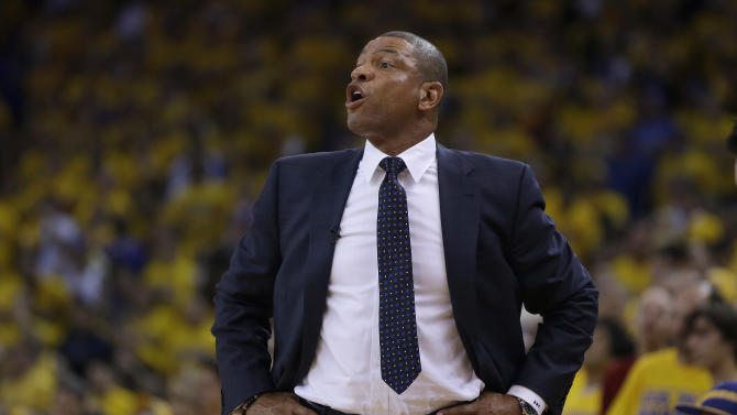 Los Angeles Clippers head coach Doc Rivers talks to his team from the sideline during the first quarter of Game 6 of an opening-round NBA basketball playoff series against the Golden State Warriors in Oakland, Calif., Thursday, May 1, 2014. (AP Photo/Marcio Jose Sanchez)