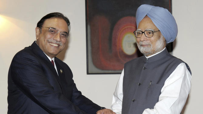 In this photo released by India's Press Information Bureau, Pakistan President Asif Ali Zardari, left, shakes hands with Indian Prime Minister Manmohan Singh prior to their meeting at the latter's residence in New Delhi, India, Sunday, April 8, 2012. Zardari arrived in India on a private trip Sunday that also gives him a chance to meet Indian leaders amid a thaw in relations between the two South Asian rivals. (AP Photo/Press Information Bureau)