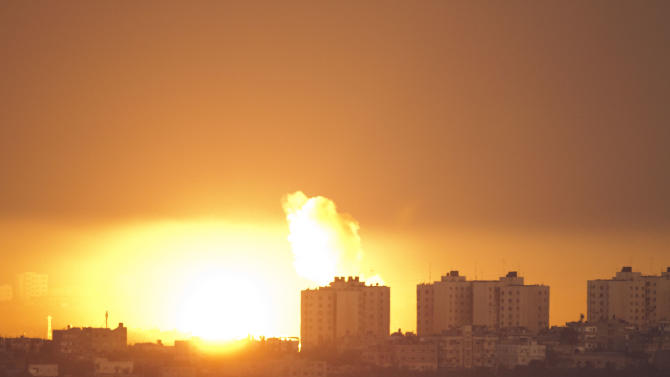 Explosion and smoke rise following an Israeli air strike in the northern Gaza Strip, seen from the Israel Gaza Border, southern Israel, Thursday, Nov. 15, 2012. (AP Photo/Ariel Schalit)