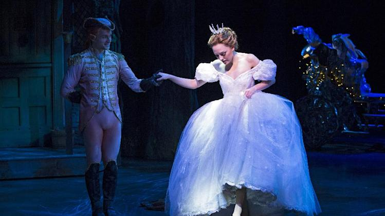 """This theater image released by Sam Rudy Media Relations shows Laura Osnes as Cinderella, slipping on glass slippers designed by Stuart Weitzman, during a performance of """"Rodgers + Hammerstein's Cinderella on Broadway.""""  Weitzman knows how to make shoes that make a splash. For years, he made the """"million-dollar Oscar shoes,"""" diamond-covered footwear that a celebrity would wear to the Academy Awards. (AP Photo/Sam Rudy Media Relations, Carol Rosegg)"""