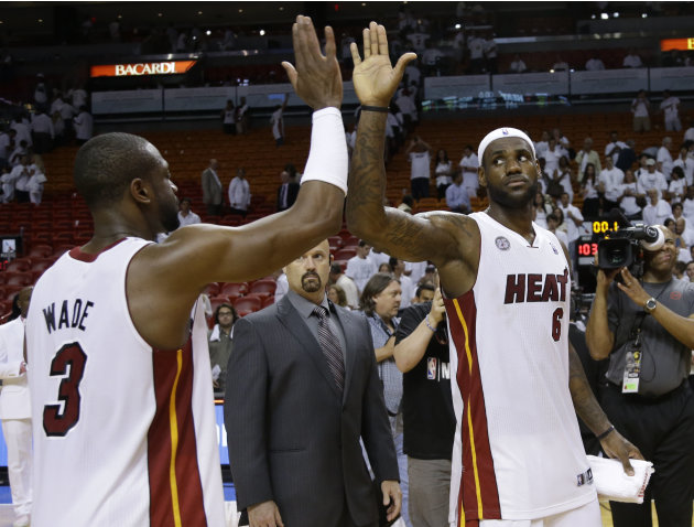 Miami Heat small forward LeBron James (6) is congratulated by  Dwyane Wade (3) after defeated the Indiana Pacers in Game 1 in their NBA basketball Eastern Conference finals playoff series, Wednesday,