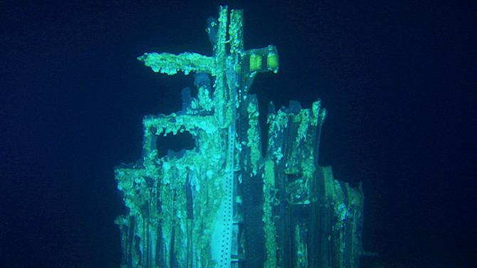 This image provided by Bezos Expeditions shows growths on a Saturn V rocket stage structure on the bottom of the Atlantic Ocean in March 2013. An expedition led by Amazon CEO Jeff Bezos pulled up two rocket engines that helped boost Apollo astronauts to the moon. Bezos and NASA announced the recovery on Wednesday, March 19, 2013. The sunken engines were part of the Saturn V rocket used to bring astronauts to the moon during the 1960s and 1970s. After liftoff, they fell into the ocean as planned. (AP Photo/Bezos Expeditions)