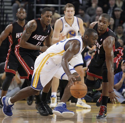 Wright leads Warriors past Heat 111-106 in OT