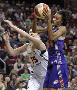 Phoenix Mercury's DeWanna Bonner, right, pulls down a rebound in front of Seattle Storm's Lauren Jackson during the first half of Game 1 of a first-round WNBA playoff basketball series Thursday, Sept. 15, 2011, in Seattle. (AP Photo/Elaine Thompson)