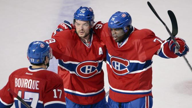 Montreal Canadiens defenseman P.K. Subban (76) celebrates with teammates Andrei Markov (79) and Rene Bourque after scoring the first goal against the Ottawa Senators during the first period of Game 5 first round NHL hockey Stanley Cup playoff series Thursday, May 9, 2013, in Montreal. (AP Photo/The Canadian Press, Ryan Remiorz)