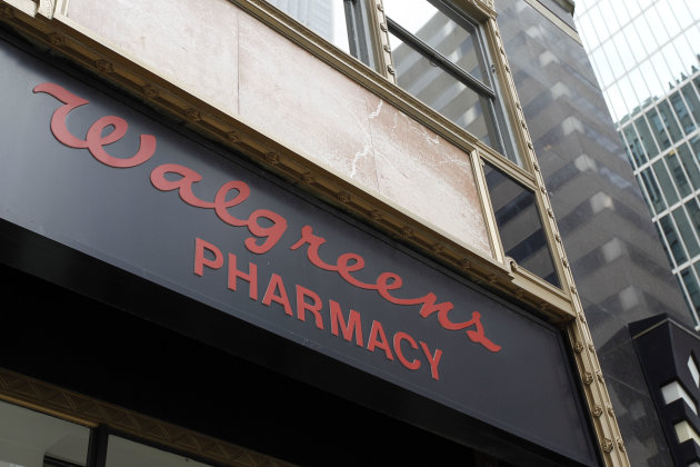 <p>               FILE - In this June 20, 2011 file photo, a Walgreens pharmacy sign is displayed in Philadelphia. The nation's largest drugstore chain says it earned $353 million, or 39 per share, in its 2012 fiscal fourth quarter. (AP Photo/Matt Rourke, File)