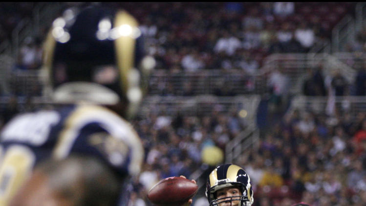 St. Louis Rams quarterback Sam Bradford, right, throws a 7-yard touchdown pass to tight end Lance Kendricks, left, during the first quarter of an NFL football game against the Arizona Cardinals, Thursday, Oct. 4, 2012, in St. Louis. (AP Photo/Tom Gannam)
