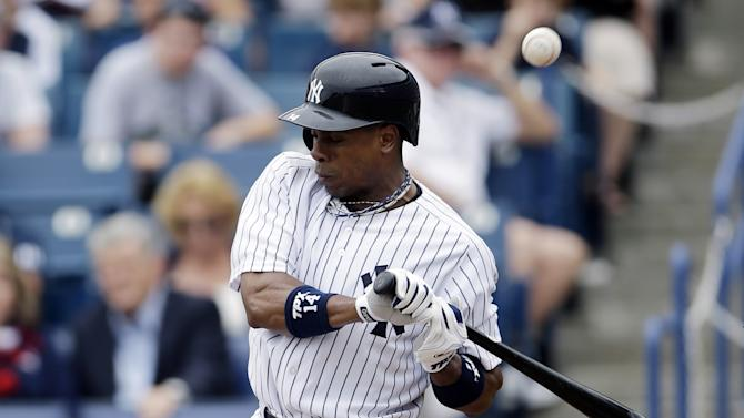 New York Yankees' Curtis Granderson is hit by a pitch from the Toronto Blue Jays' J.A. Happ during the first inning of a spring training exhibition baseball game, Sunday, Feb. 24, 2013, in Tampa, Fla. Granderson left the game after the play. (AP Photo/Matt Slocum)