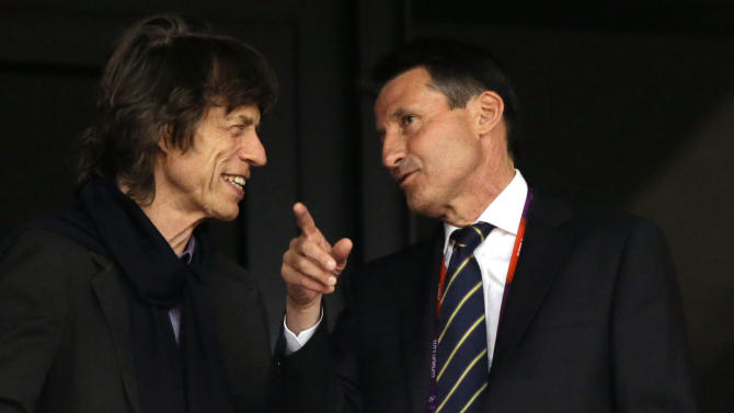 Musician Mick Jagger, left, and Sebastian Coe, chairman of the London 2012 Organising Committee for the Olympic Games attend an evening session of athletics in the Olympic Stadium at the 2012 Summer Olympics, London, Monday, Aug. 6, 2012. (AP Photo/Matt Slocum)
