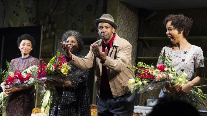 "FILE - In this April 3, 2014 file photo shows Anika Noni Rose, from left, LaTanya Richardson, Denzel Washington and Sophie Okonedo at the curtain call for the opening night of ""A Raisin In The Sun"" in New York. President Barack Obama and first lady Michelle Obama caught the American masterpiece Friday night, April 11, 2014, at the Ethel Barrymore Theatre, where it first opened more than 50 years ago. They took their seats to huge applause. (Photo by Charles Sykes/Invision/AP, File)"
