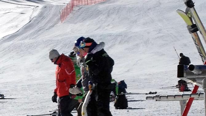 COREECTS PHOTOGRAPHER NAME In this image provided by Maris Van Slyke, which has been authenticated based on its contents and other AP reporting, reigning Olympic downhill champion Lindsey Vonn, center, is helped off the slope at Copper Mountain, Colo., on Tuesday, Nov. 19, 2013. Vonn crashed while training ahead of her return to racing following major knee surgery
