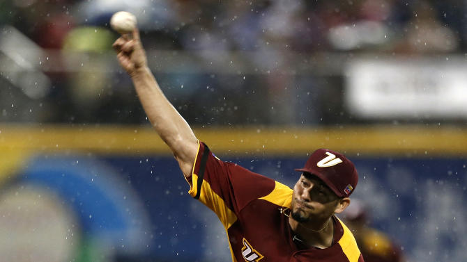 Venezuela's starting pitcher Anibal Sanchez throws in the first inning of the World Baseball Classic first round game against the Dominican Republic in San Juan, Puerto Rico, Thursday, March 7, 2013. (AP Photo/Andres Leighton)