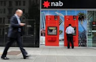 This file photo shows a National Australia Bank (NAB) ATM, pictured in Perth in 2011. NAB on Tuesday posted a Aus$1.2 billion ($1.26 bln) net profit in the three months to June 30 but revenue fell due to higher funding costs at its struggling British unit