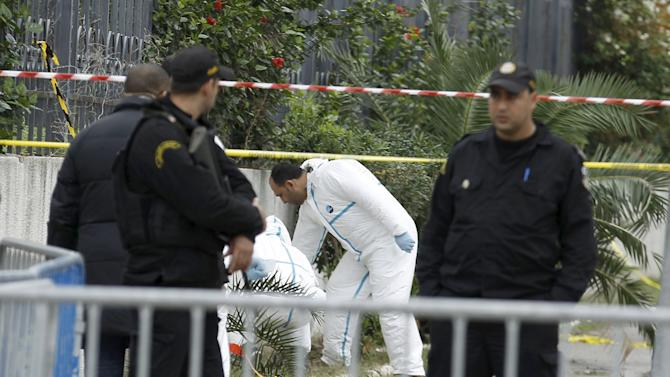 Tunisian forensics police inspect the scene of a suicide bomb attack in Tunis