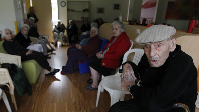 Elderly evacuated from their homes, sit in a classroom of a kindergarten in Mirabello, Italy, Sunday, May 20. 2012. A magnitude-5.9 earthquake shook northern Italy early Sunday, killing at least three people and toppling some buildings, emergency services and news reports said. The quake struck at 4:04 a.m. Sunday between Modena and Mantova, about 35 kilometers (22 miles) north-northwest of Bologna at a relatively shallow depth of 10 kilometers (6 miles), the U.S. Geological Survey said. (AP Photo/Luca Bruno)