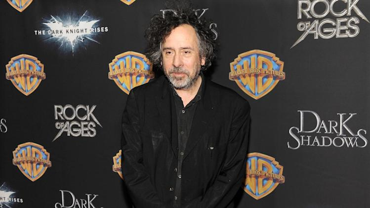 "Tim Burton, director of the upcoming film ""Dark Shadows,"" poses backstage following Warner Bros.' presentation at CinemaCon 2012, the official convention of the National Association of Theater Owners, Tuesday, April 24, 2012, in Las Vegas. (AP Photo/Chris Pizzello)"