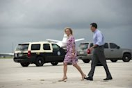 US Republican presidential candidate Mitt Romney and his wife Ann walk to their campaign bus in Palm Beach, Florida