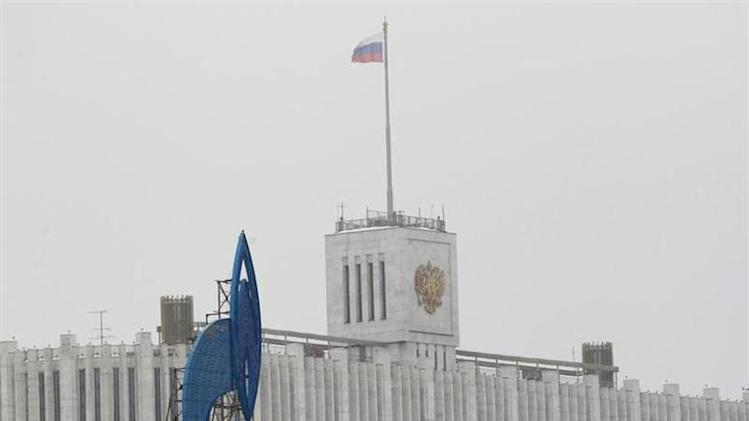The company logo of Russian natural gas producer Gazprom is seen on an advertisement in front of the White House in Moscow