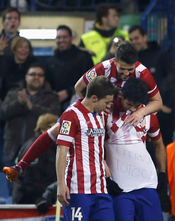 Atletico Madrid's Costa celebrates his goal against Espanyol with teammates during their Spanish first division soccer match at Vicente Calderon stadium in Madrid