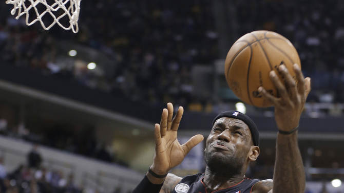 Miami Heat's LeBron James (6) puts up a shot against Indiana Pacers' Ian Mahinmi during the first half of an NBA basketball game Tuesday, Jan. 8, 2013, in Indianapolis. (AP Photo/Darron Cummings)
