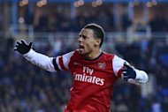 Arsenal's Francis Coquelin celebrates a goal during their English League Cup fourth round match against Reading at The Madejski Stadium in Reading, west of London, on October 30. Arsenal mounted an incredible comeback from 4-0 down to win 7-5 after extra time