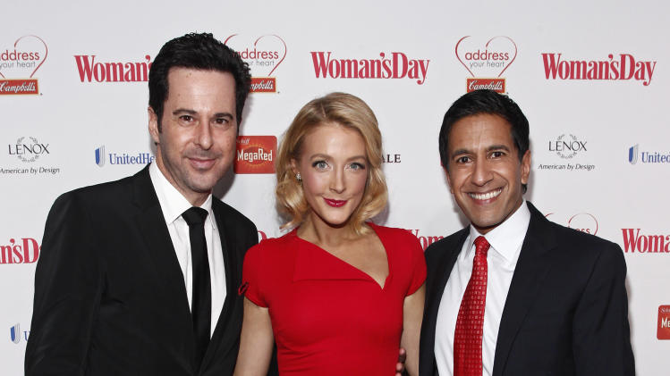 IMAGE DISTRIBUTED FOR CAMPBELL'S - From left, actor Jonathan Silverman, actress Jennifer Finnigan, and Dr. Sanjay Gupta walk the red carpet during the Woman's Day Red Dress Awards on Feb. 12, 2013, in New York City. (Brian Ach/AP Images for Campbell's)