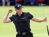 Jamie Donaldson of Wales reacts after putting on the 18th green to win the Irish Open on the final day of the 2012 Irish Open golf tournament at Royal Portrush in Northern Ireland. Donaldson, 36, shot a final round 66 to win by four strokes with an 18-under par tally