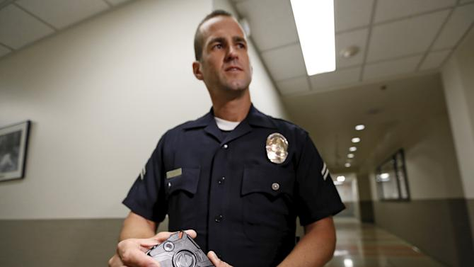 LAPD officer Stover demonstrates use of the body camera during a media event displaying the new body cameras to be used by the Los Angeles Police Department in Los Angeles, California