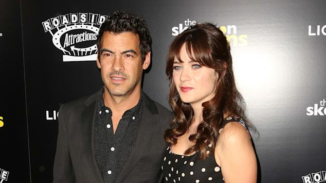 "FILE- In this Sept. 10, 2014 file photo, Jacob Pechenik, left, and Zooey Deschanel  attend ""The Skeleton Twins,"" premiere at ArcLight Theatre in Los Angeles. A spokeswoman for the 35-year-old entertainer confirmed Tuesday, Aug. 4, 2015, that Deschanel recently married Jacob Pechenik and gave birth to the couple's baby girl. No other details were provided. (Photo by Brian Dowling/Invision/AP, File)"